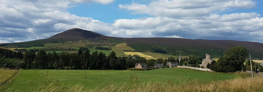 This is a slightly more distant view of the Tap o Noth from the A97 on the approach to the village of Rhynie, You can still make out the flat top though - the old hillfort.