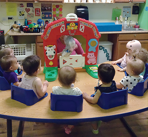 A special Friday feature. Our Older Infants take in a farm puppet show and play with some fuzzy bugs below.
