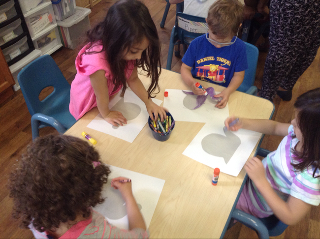 The students use exploratory art as they practice their Spanish vocabulary.