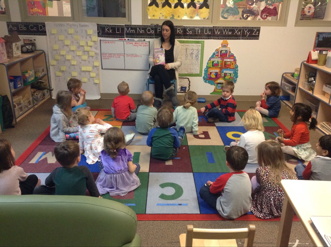 Preschool students gather for circle time and begin their day with a story.