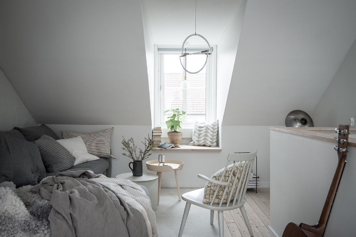 Lot's of light and a window seat to look out over the rooftops.