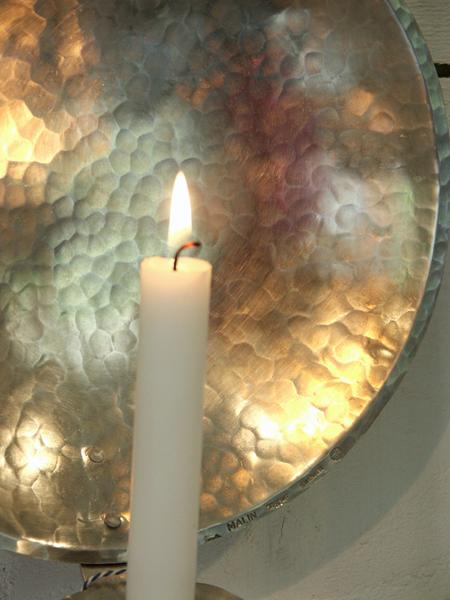 Brass or Pewter wall sconce, hand hammered by Malin Appelgren Paulsson.