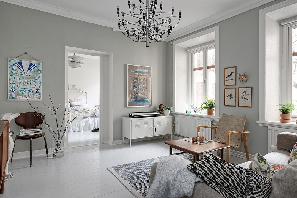Grey walls and mixed woods in this Scandinavian home.