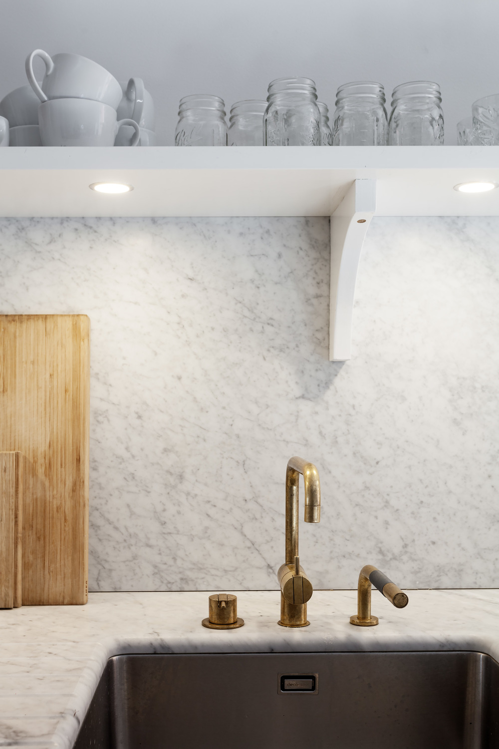 White, marble and brass kitchen.