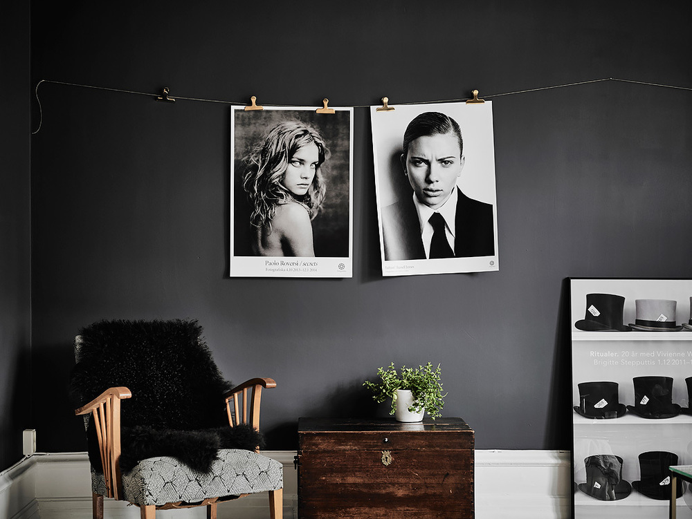 Unframed photography hanging from gold paperclips on a wire..looks great and easy to switch it up.