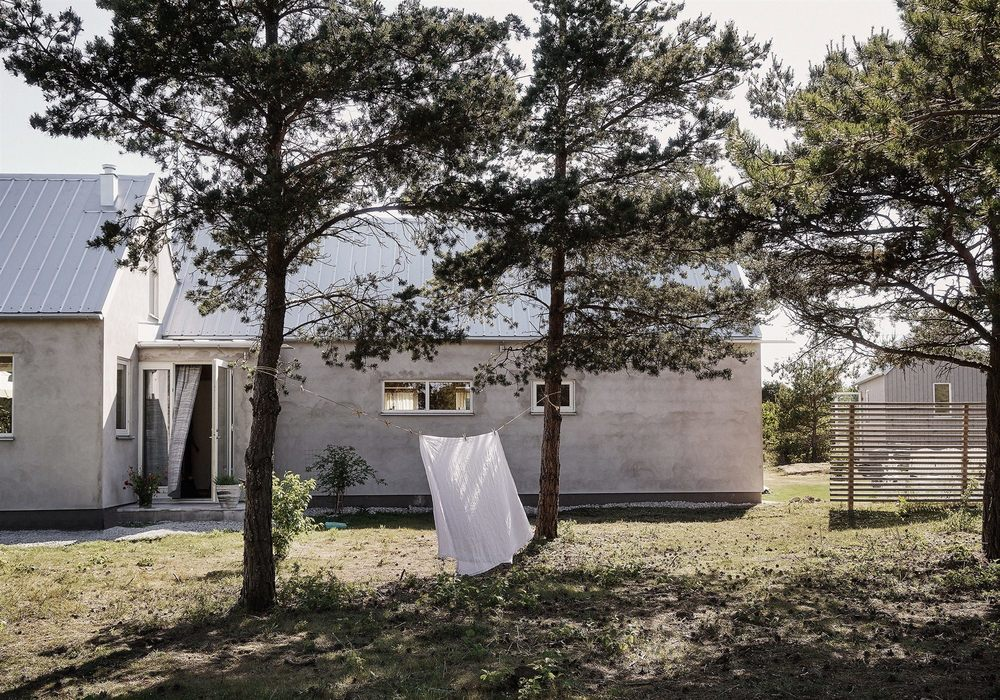 Scandinavian summer house with concrete and bare wood.
