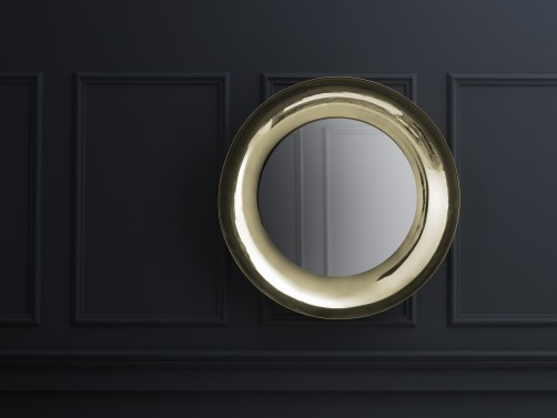 Skultunas round and chunky Brera mirror in brass.