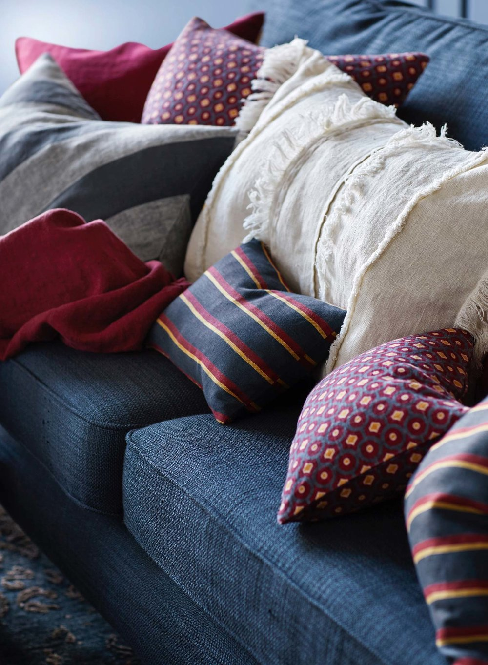 Fall couch in denim blue and maroon.