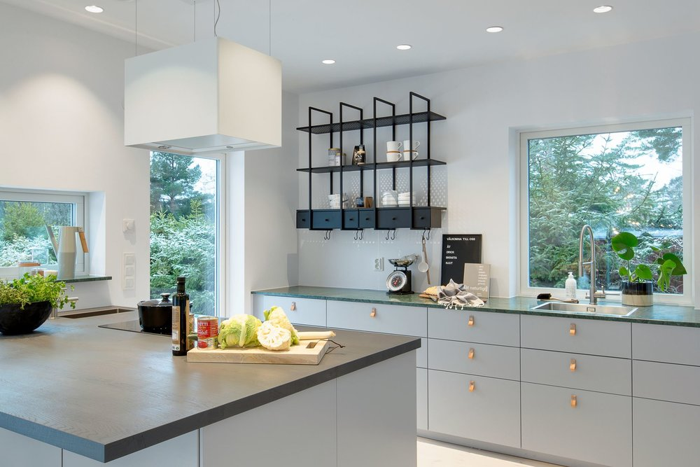 Modern Scandinavian kitchen with green marble countertops.