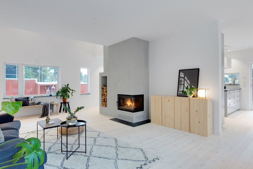 Modern Scandinavian living room with fireplace.