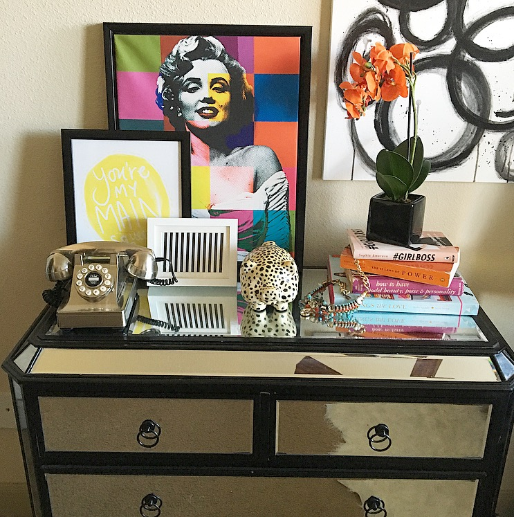 I've layered a couple of art work on  my actual dresser , to prevent holes in the wall. But I do have a painting hanging in which I used the Command hanging strips.
