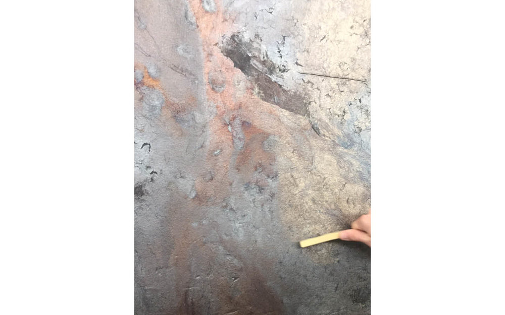 After the panel cools for 3-5 days, the surface is lightly wire brushed to remove ash from within the mold and reveal the beautiful coloration of the bronze