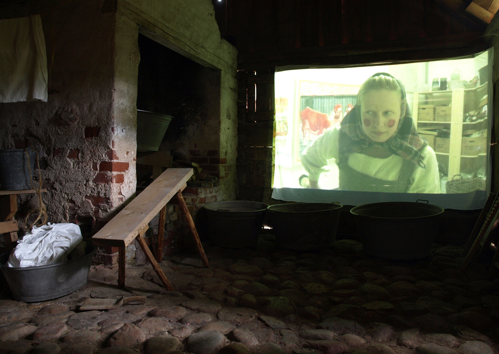 Installation of the video, Målarens färd (The Painter's Flight), 2013, in an old brew house forming part of the open air museum at Hallands Art Museum.