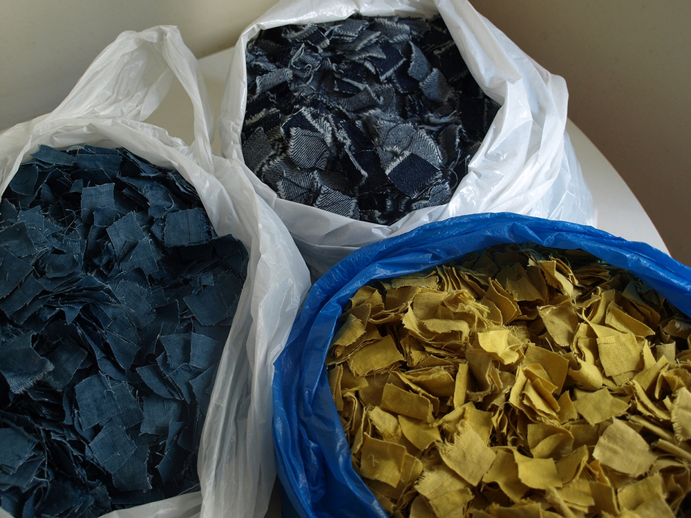 Chopped up dyed fabric, and chopped up denim scraps obtained from a jeans factory in Guangzhou