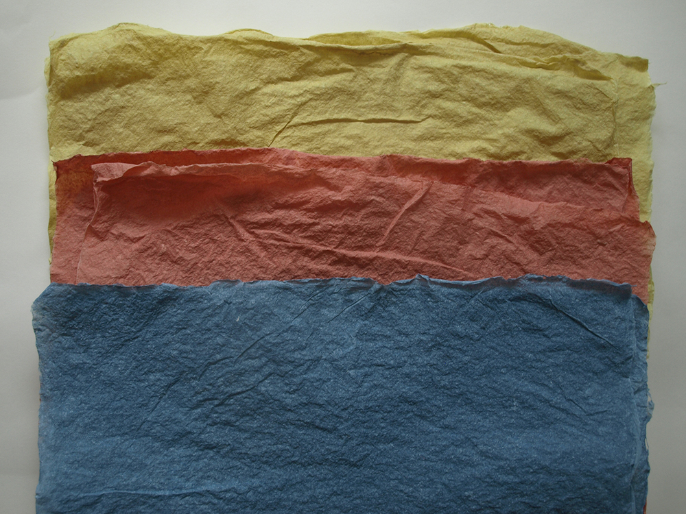 Crinkly, air-dried paper, made from linen dyed with indigo and madder.