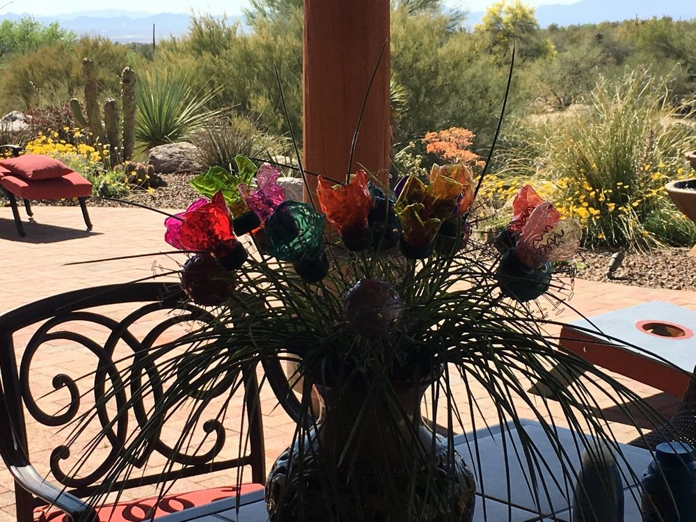 stunning upcycled water bottle flowers adorn a Tucson patio!