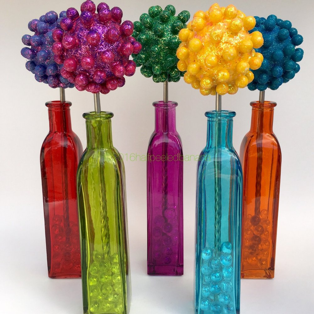 perfect tabletop flowers in purple, bright pink, dark green, yellow and dark blue!
