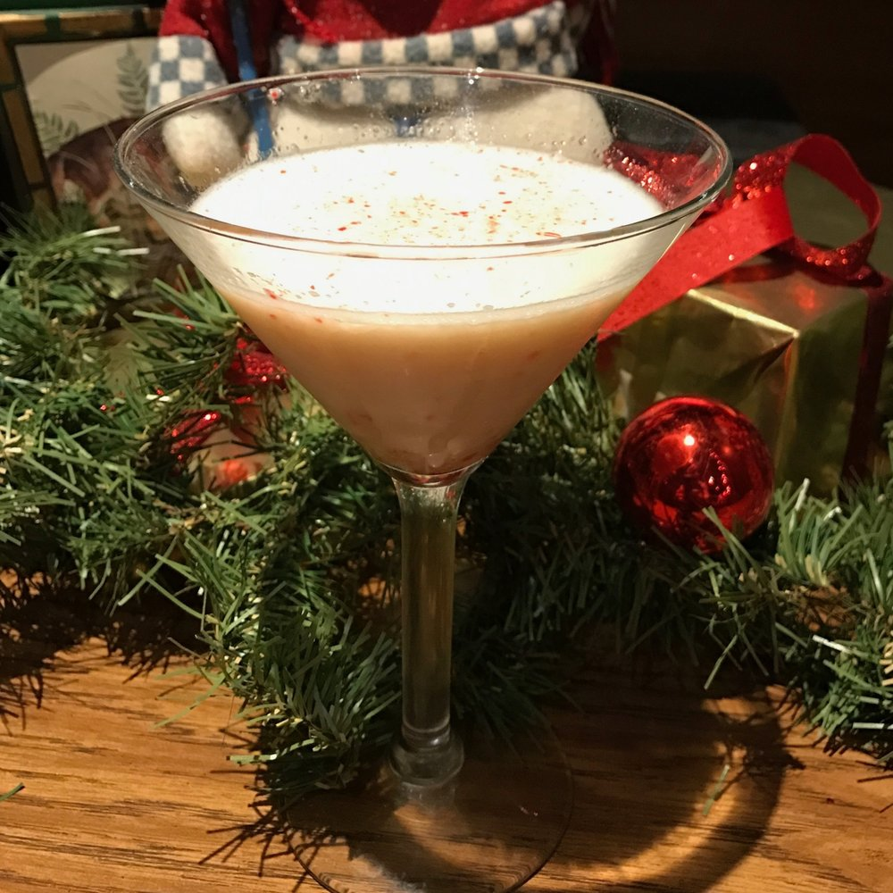 DIRTY CANDY CANE MARTINI  Vanilla vodka, creme de menthe, a splash of Bailey's, served in a chilled martini glass and garnished with crushed candy cane.