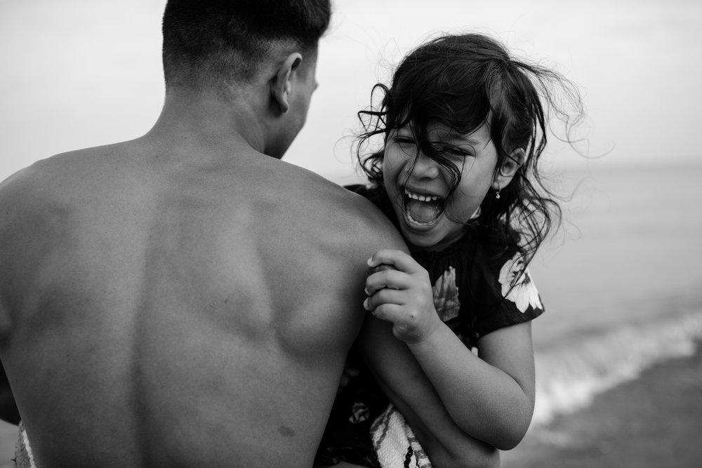 michigan-storytelling-photographer-esch-road-beach-empire-mi-santellano-family-176.jpg