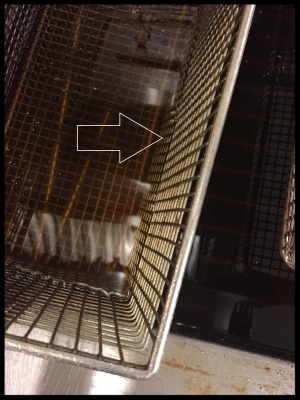 Fryer Basket: An example of looking through  the oil to see the correct row of wire.