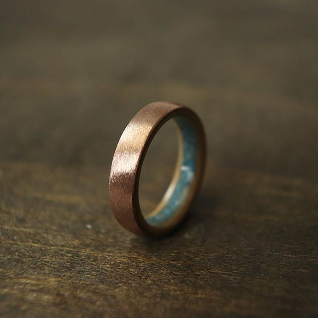 Brushed rose gold and a pine liner with a turquoise inlay. I've been dying to try this ring for a while and I love the way it turned out! The turquoise and rose gold compliment each other so perfectly. . . . #woodring #woodenring #wedding #weddingband #engaged #engagement #weddingday #groom #weddingring #love #handmade #weddingday #engagement #engagementring #ring #mensstyle #menswear #mensfashion #silver #walnut #gold #goldring