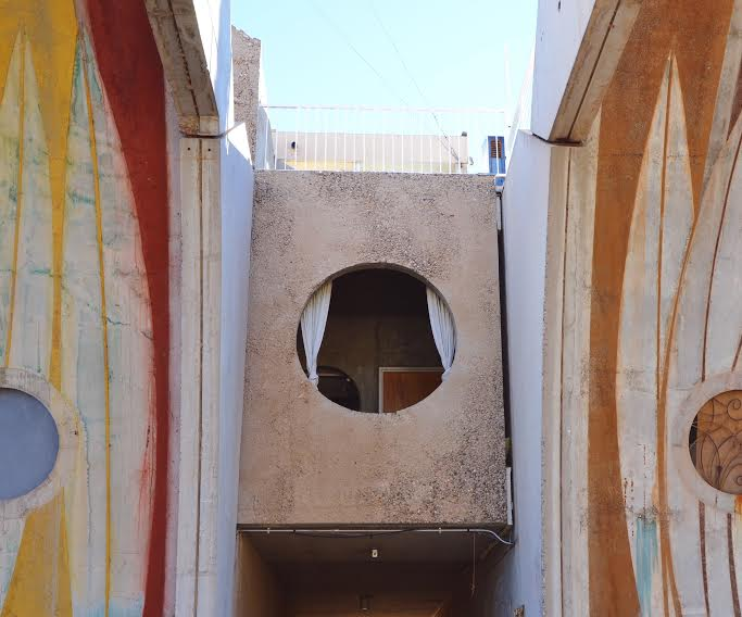 A dormitory window sandwiched between the two sections of the Vault / photo by Maleeha Sambur