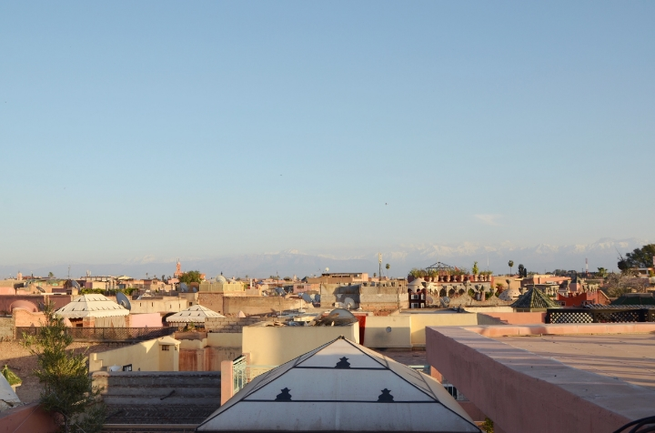 Medina rooftops, with the Atlas Mountains in the background | photo by Maleeha Sambur