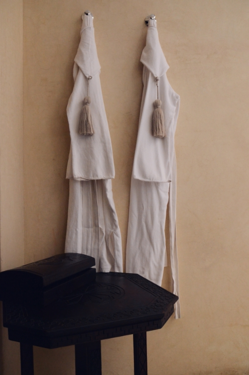 Robes hanging at Riad Dixneuf la Ksour | photo by Maleeha Sambur