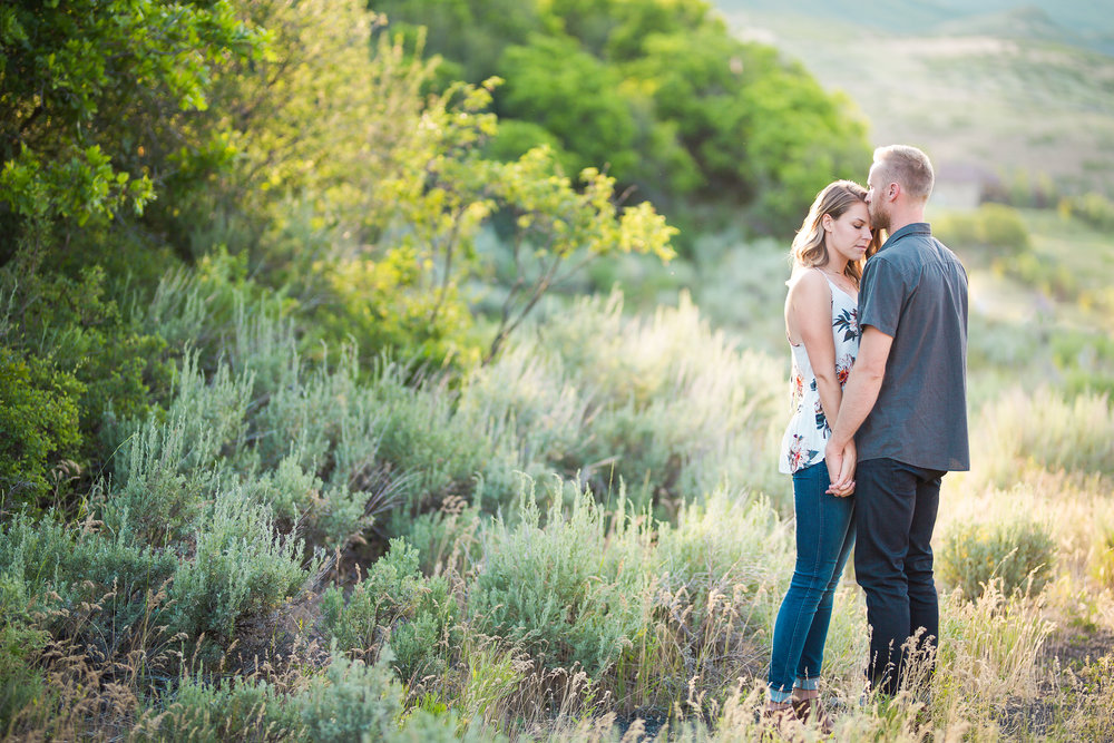 Engaged Couple in Sage Brush and Bushes