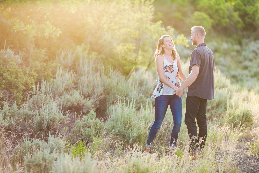 Couple Laughs During Engagement Pictures