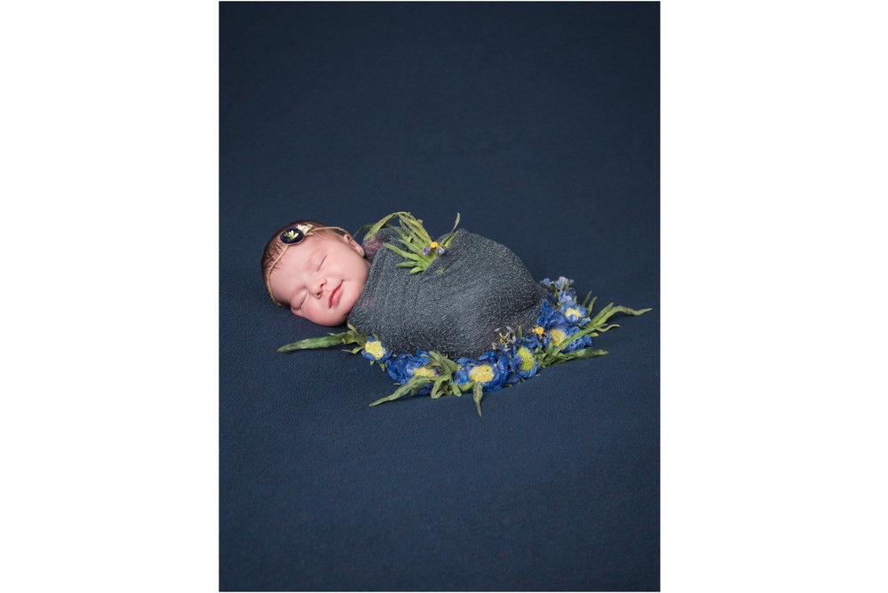 Smiling Newborn in Navy