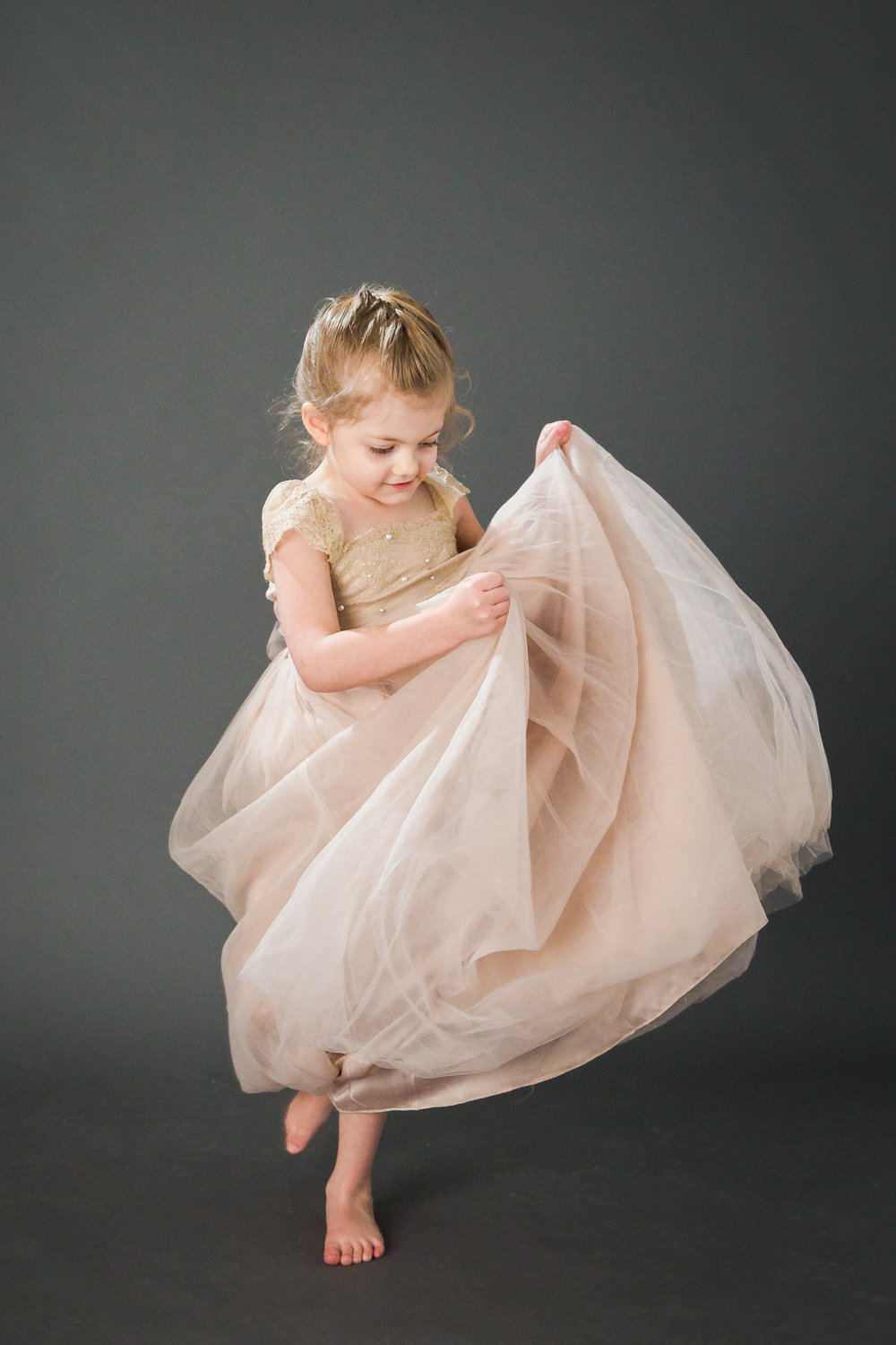 Little Girl Spinning in Gown