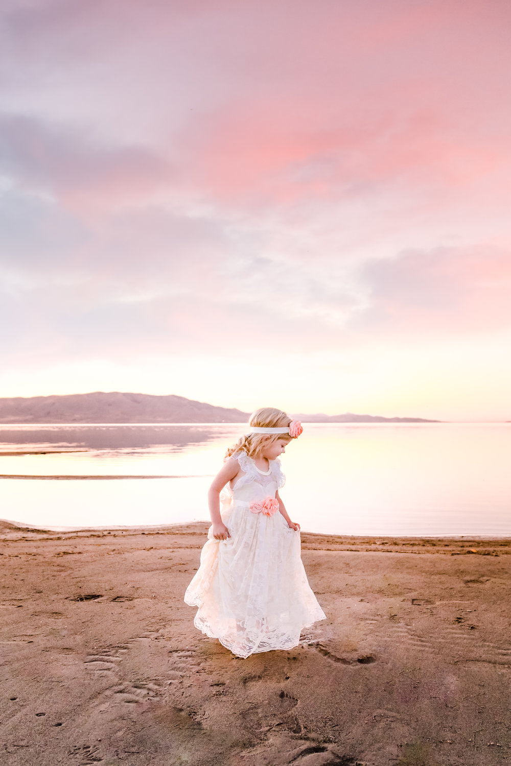 Girl in a Lace Dress Spins on the Beach at Sunset
