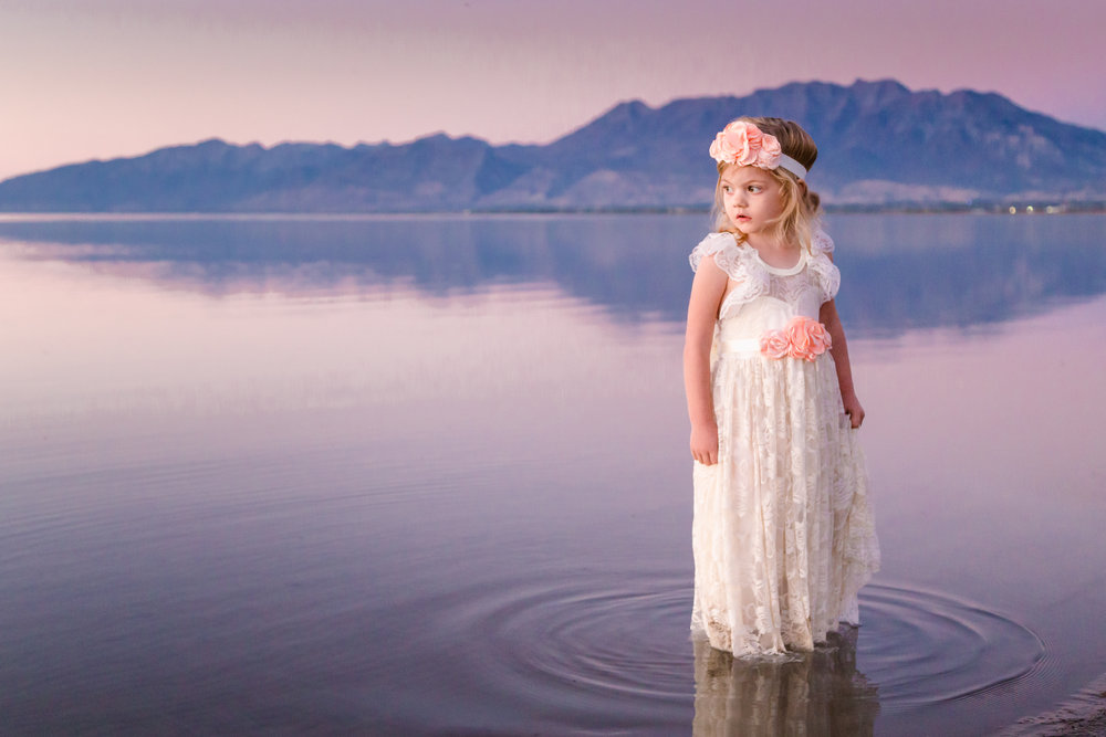 Little Girl Stands in Lake at Blue Hour