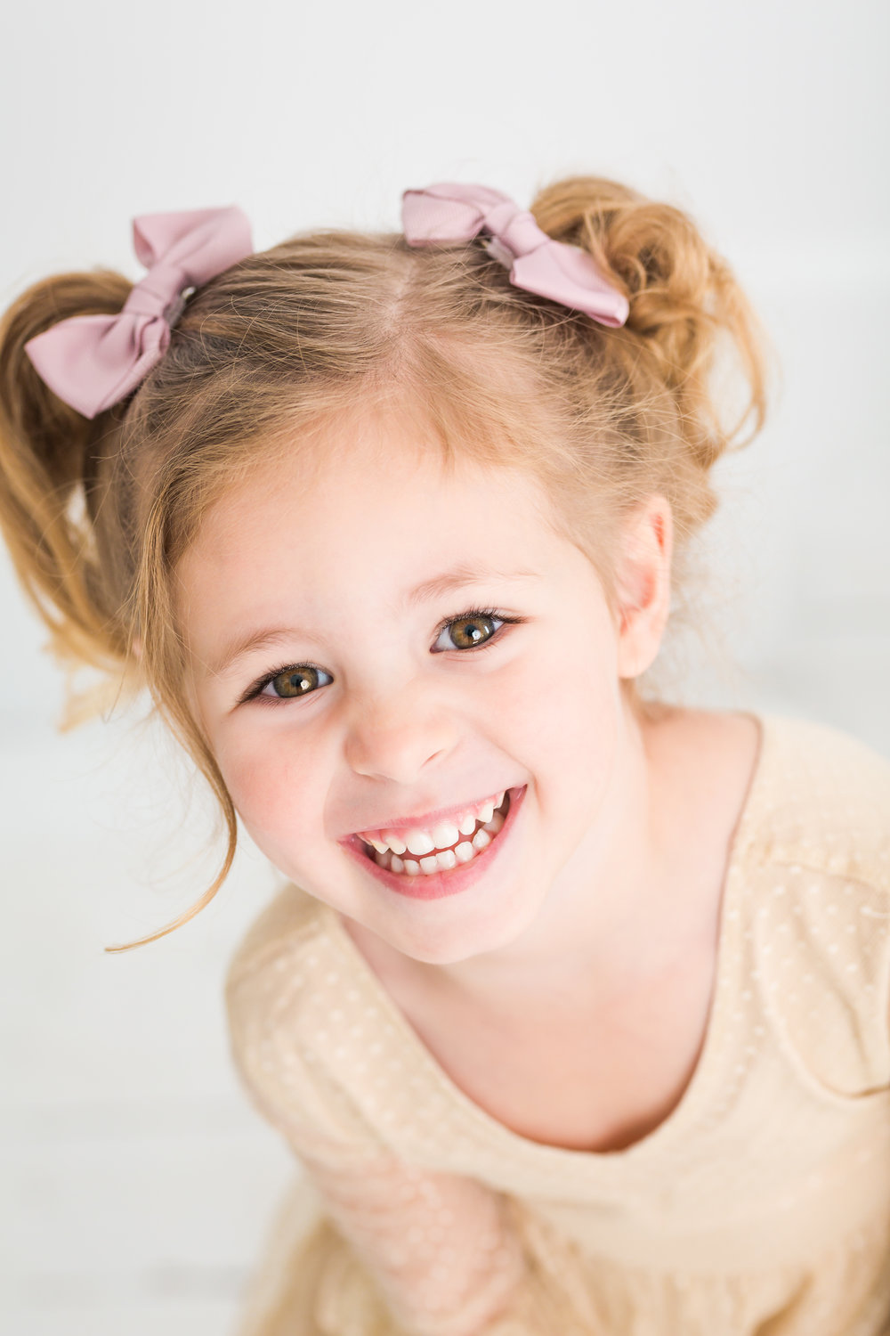 Grinning Girl with Pig Tails