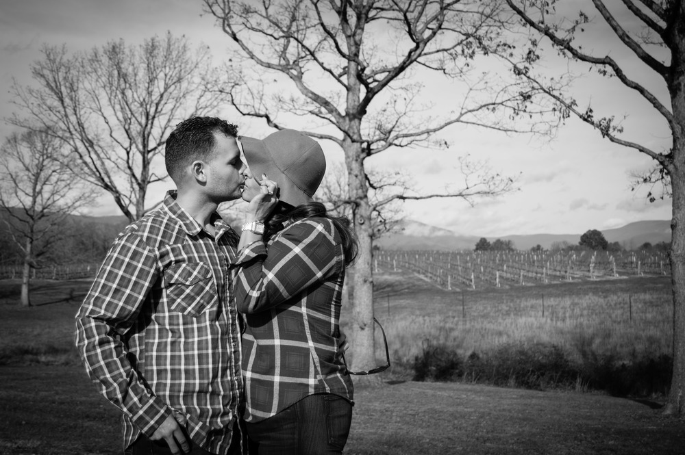 Stealing a kiss in the warm winter sun, with Grace Estate Vineyard looking lovely in the background.