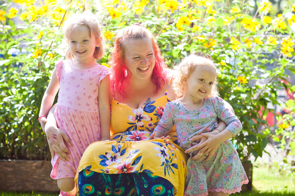 April laughs with her two daughters. Photo courtesy of Snickerdoodle Photography.