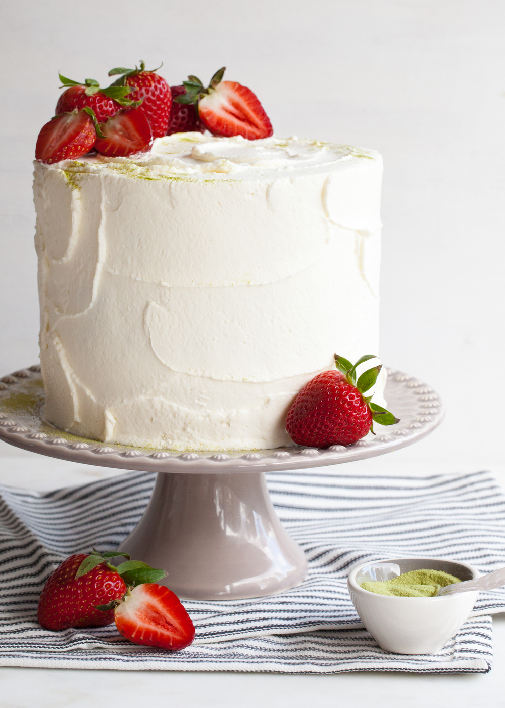 Matcha (green tea) genoise cake with strawberries and cream cheese whipped cream.