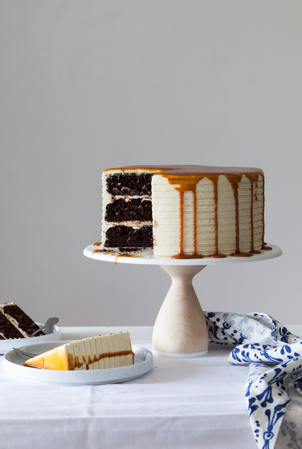 London Fog Cake with classic chocolate cake, earl grey buttercream, and salted caramel sauce.
