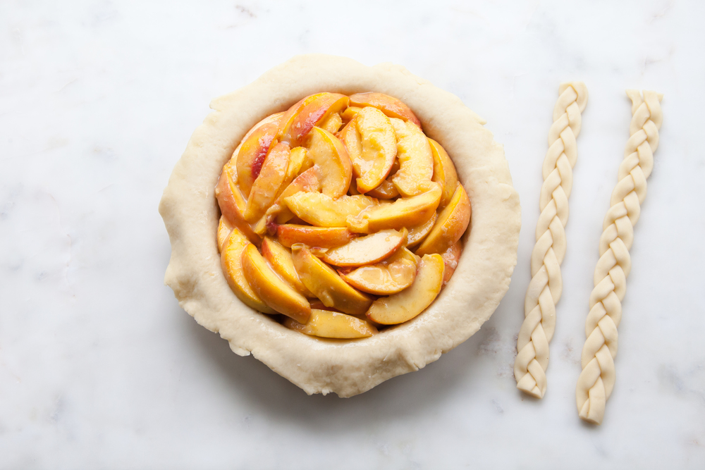 Cinnamon Peach Pie with an all-butter braid pie crust.