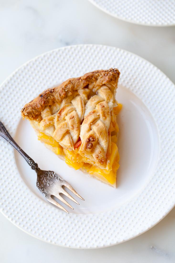 Cinnamon Peach Pie with an all-butter braid pie crust.