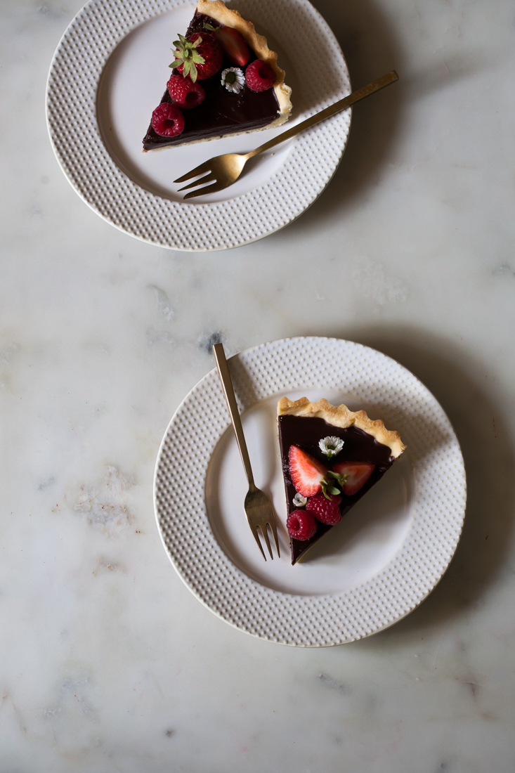 Chocolate Tart with buttery crust and berries.