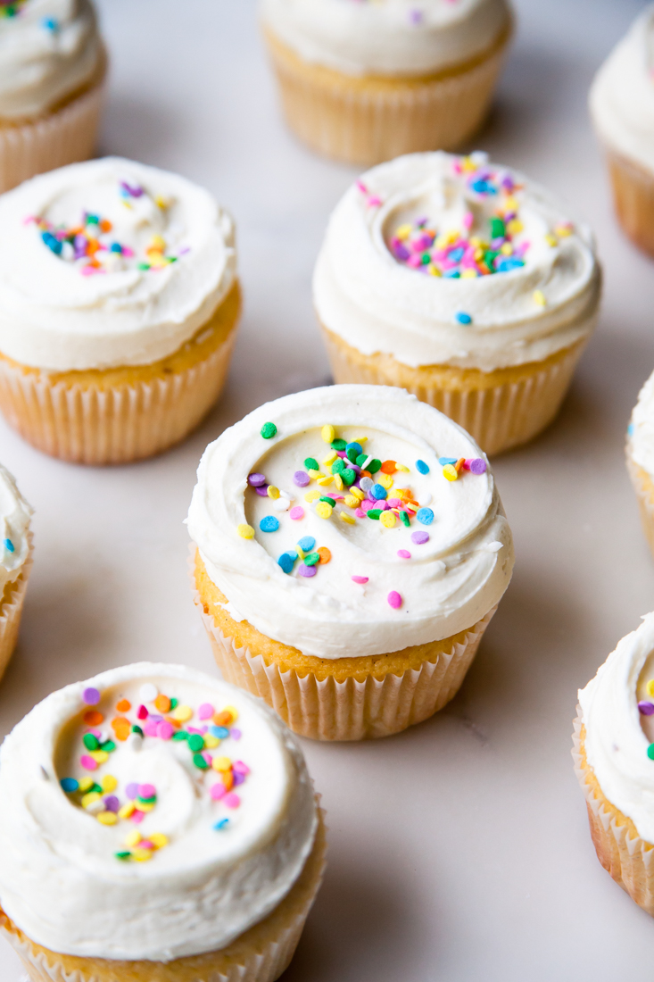 Vanilla Cupcakes with Vanilla Bean Frosting.