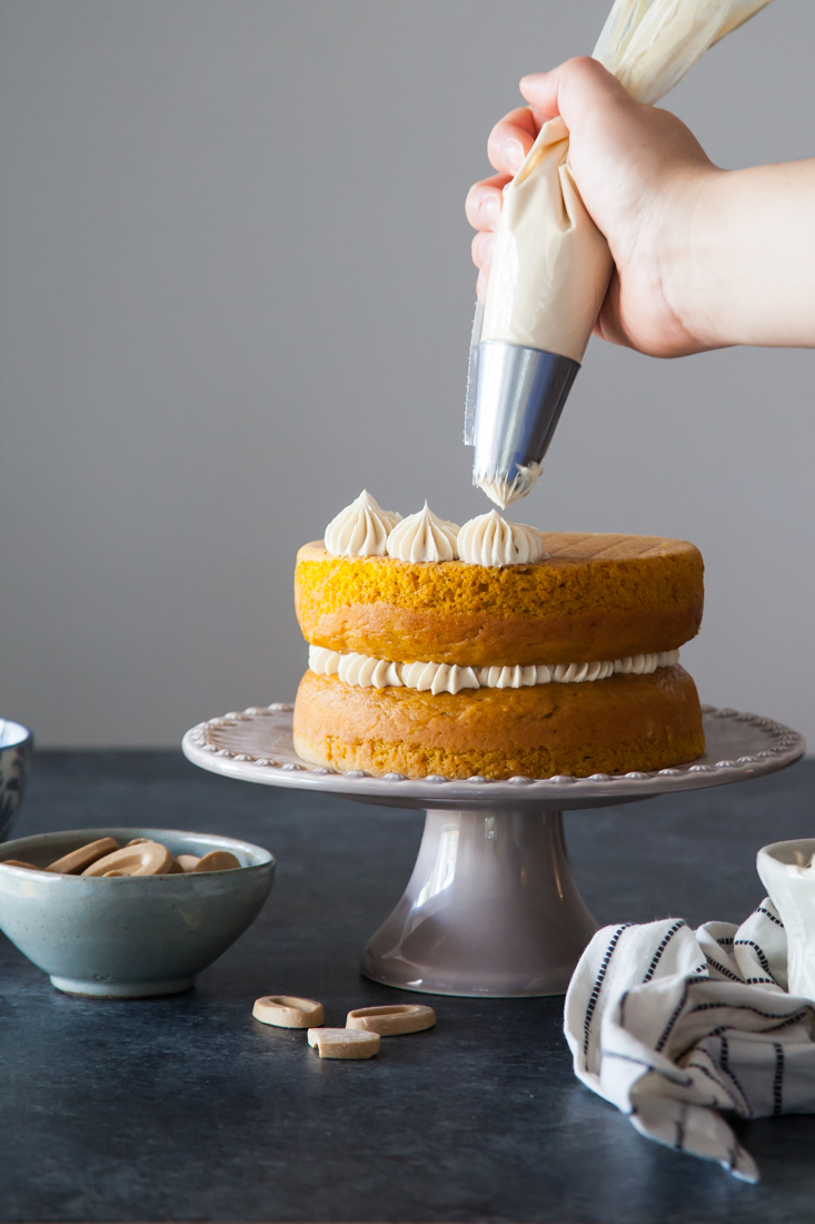 Pumpkin Creme Brûlée Cake Recipe with vanilla pastry cream and caramelized white chocolate frosting.