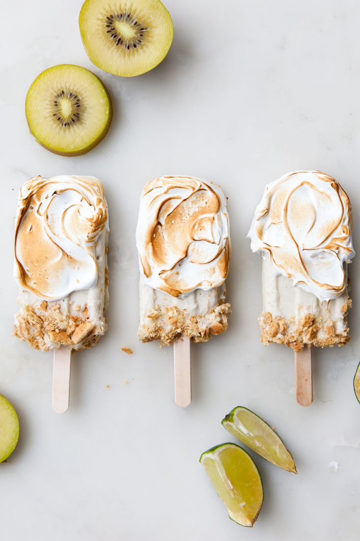 Kiwi Lime Pie Popsicles with torched meringue.  Non-dairy