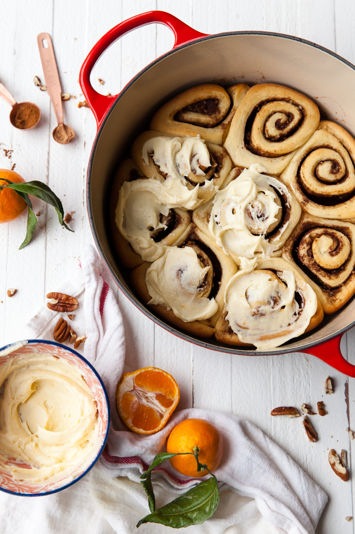 Over-night Eggnog Cinnamon Rolls with Orange Vanilla Glaze