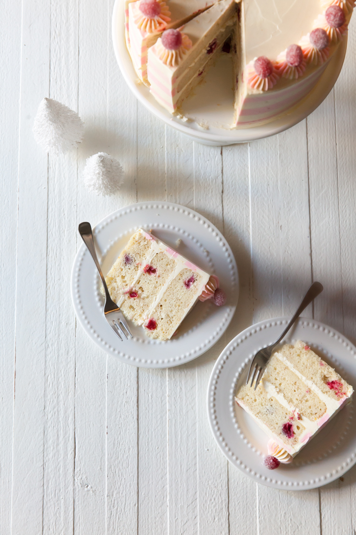 Sparkling Cranberry Orange Cake recipe with white chocolate buttercream.