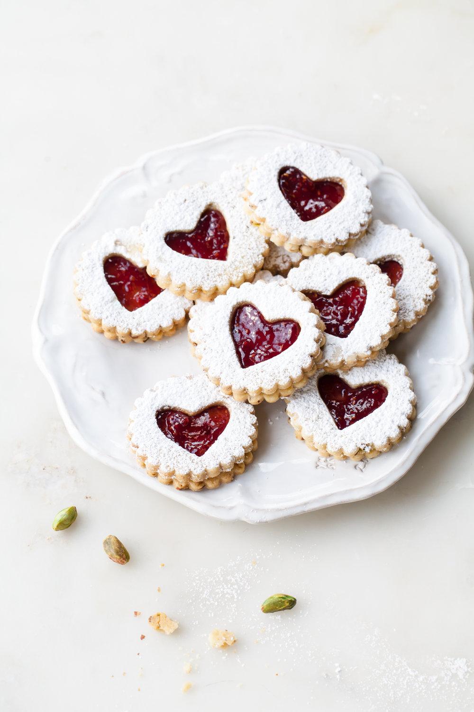 Pistachio Linzer Cookies with raspberry jam filling