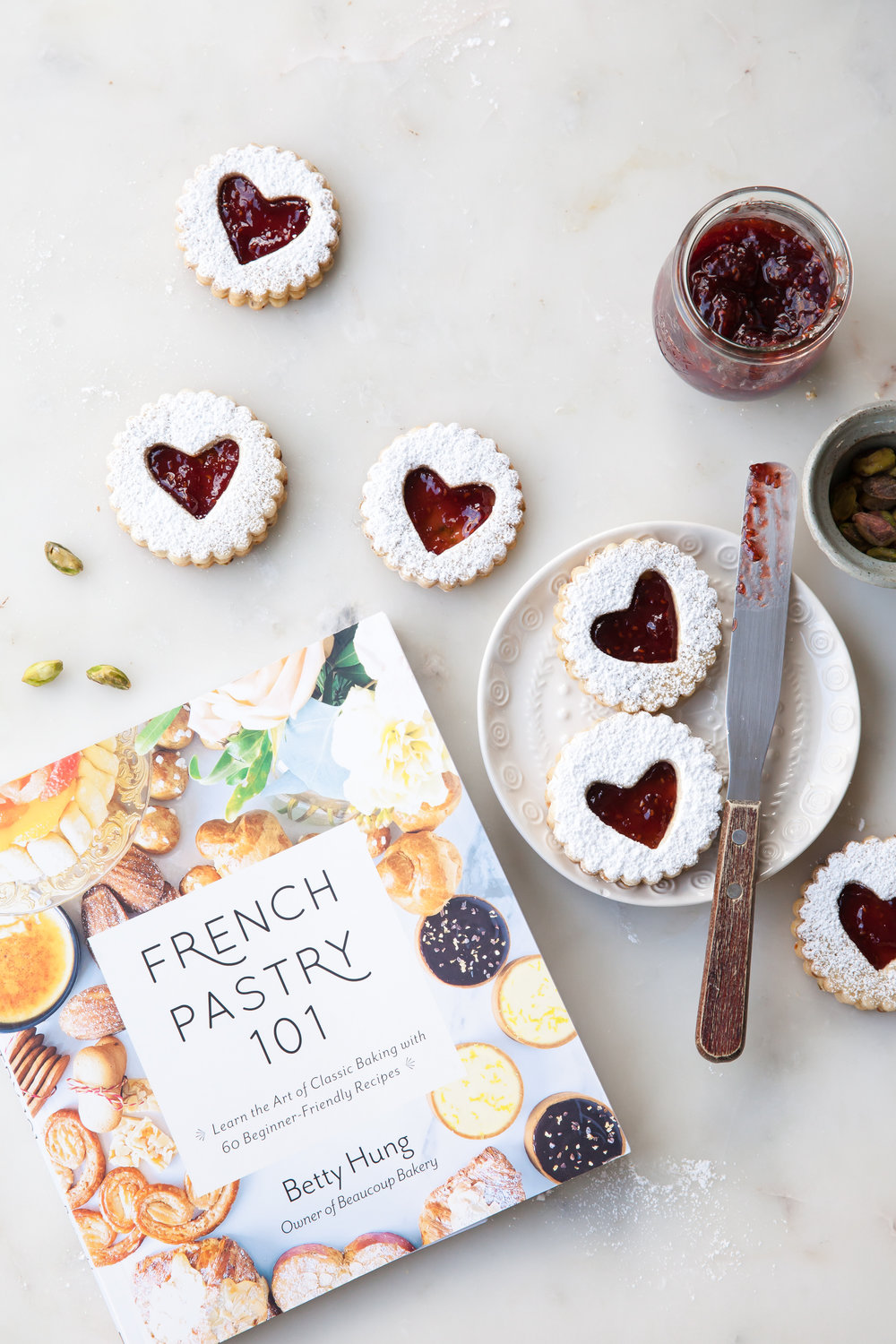 Pistachio Linzer Cookies with raspberry jam filling