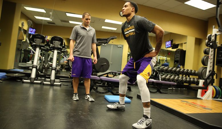 Tim DiFrancesco of the Los Angeles Lakers w/Jordan Clarkson